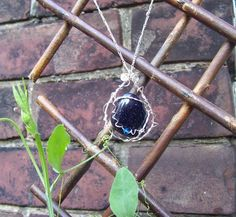 """""""My God, It's Full of Stars"""" pendant in blue goldstone, sterling silver, and crystal."""