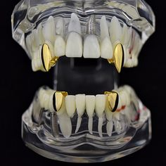 &nbsp&nbsp PRE-MADE GRILLZ Sink your teeth into a Best Grillz™ fang grillz combo set. No-frills, gold plated teeth for a solid design that hits hard. Vampire Grillz, Fang Grillz, Vampire Fangs, Gold Fangs, Gold Teeth, Silver Grillz, Diamond Grillz, Grills Teeth, Bracelet