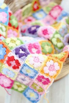 A colourful crochet traditional granny square blanket