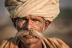Portrait of a Camel Trader - Pushkar Camel Fair is the last stop of my Nov 2015 India photo tour, I came across this camel trader at the fair ground, and he stopped for me to take his portrait.  williamyuphotoworkshops.com