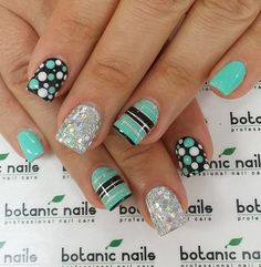 Sea green and black themed spring nail art design. Make sure your nails truly stand out with this quirky design of stripes and polka dots. Bring more attitude to your nails with silver glitter polish. by trudy Fancy Nails, Trendy Nails, Diy Nails, Cute Nails, Spring Nail Art, Nail Designs Spring, Toe Nail Designs, Nails Design, Fingernail Designs