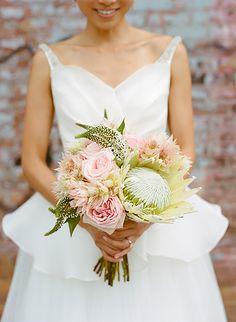 Pretty protea bouquet: http://www.stylemepretty.com/2015/03/06/multi-cultural-brooklyn-loft-wedding/ | Photography: Jenny Kim - www.jennykimphoto.com/