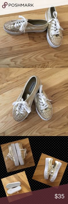 Golden Opportunity Platform Golden Sneakers! Fabulous metallic gold metallic with fun gold studs detail. Canvas lace up shoe style comfort. Quality EUC. Few light marks on the sides. Bling out with these classic Steve Madden sneaker silhouette! Steve Madden Shoes Sneakers
