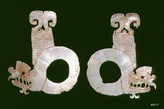 Maya Shell mother of pearl. Pair of Tlaloc eyepieces in form of serpents.