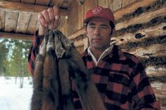Wawa-area trapper George Karasek with a set of marten. Image via Fur Institute of Canada