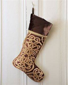 The Bronze Scroll Stocking is designed with comforting bronze tones and features elaborate gold scrollwork.