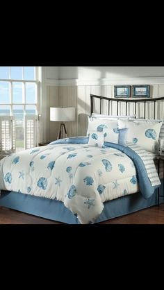 Blue and white seashell comforter.