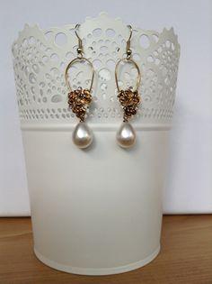 Pendientes perla A33447. 7€