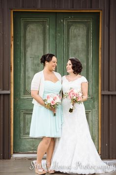 Rainy Day Wedding -- It was raining in this picture! We found this gorgeous green door with a small covering and bridesmaids took turns walking out with an umbrella.
