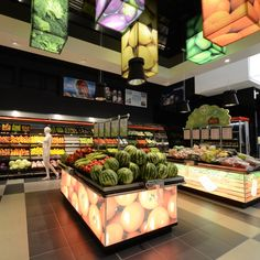 Every important area in the store has been emphasized with architectural interventions in the ceilings, floorings, furniture, lightning solutions and info graphics. Produce Displays, Fruit Displays, Visual Merchandising, Vegetable Shop, Retail Solutions, Food Retail, Retail Store Design, Retail Stores, Fruit Shop
