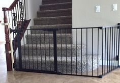 Large Sectional Baby Gate Installed At Bottom Of Stairs
