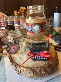 University of Alabama country themed center piece. Mason jars, salt shakers, and votives on top of a sliced tree branch.