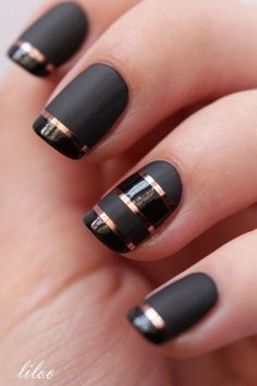 Black Matte Nails with Rose Gold Strips for Detail.