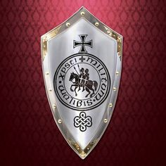 All steel shield with polished brass & heavy rivets from Marto of Spain. Depicts the seal of the Templars, a horse ridden by two riders and famous black cross. Knight Tattoo, Silver Knight, Knight Shield, Medieval Shields, Crusader Knight, Medieval Helmets, Armadura Medieval, Masonic Symbols, Famous Black