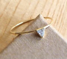 A whisper thin band paired with a triangular stone makes a modern statement.