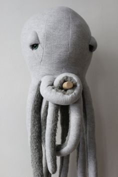The Big Octopus, one meter of magic and kindness. Made in France. Made from 100% Cotton (top) and 100% wool (bottom). Stuffed with polyester fiber.