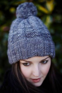 This cozy hat pattern offers a fun way to learn or practice reversible cables.