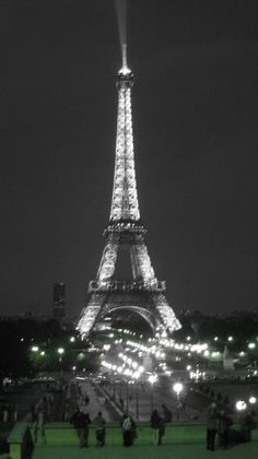 Paris, France - a pretty pic of the Eiffel Tower at night when it's lit up for all to watch from a distance
