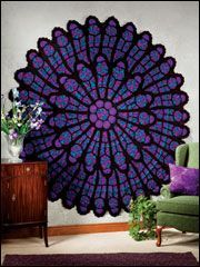 To amazing for words. This afghan is made to look like a cathedral stained window.