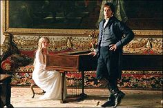 Georgiana Darcy (Tamzin Merchant) at her pianoforte with her brother Fitzwilliam