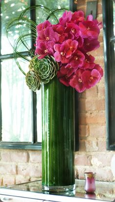 Floral Arrangement ♥ mixing succulents and florals. ♥ this idea of a vase lined with leaves ~ Here, Dutch Vanda orchids, echeveria cactus, in a tall cylinder glass vase lined with banana leaves and decorative vines. Arte Floral, Deco Floral, Green Centerpieces, Wedding Centerpieces, Wedding Decor, Wedding Dinner, Succulent Centerpieces, Tall Centerpiece, Centrepieces