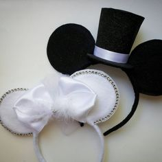 Custom made Bride & Groom Mouse Ears.  Bride ears have a small white puff veil in the back. Colors can be customized on both ears. Headband is one