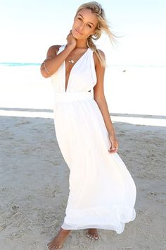 The beautiful Muse Maxi Dress is a floor length style in white with triangular bust cups & elasticated under the bust with gathering. Designed with a frilled hem detail, a sheer chiffon overlay & a unique crochet racerback design. Comes with a detached sash belt for fastening, regular fit. By Sabo Skirt