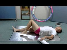 Feldenkrais Rotation of pelvis with roller halfway on the back.