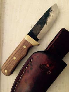 Drop point hunter knife with brass guard and pins , made from high carbon steel, and features a rough forged finish. From Carter & Son Forge by J.D. Carter Blacksmith. Check us out on etsy, facebook, and instagram.