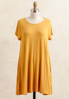 Crafted in a vibrant mustard-yellow hue, this incredibly soft dress features a swinging trapeze silhouette, short sleeves, and a rounded neckline. It's designed with plenty of stretch and...