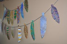 Feathers {Kid Craft}- love this, they are made with spaghetti!
