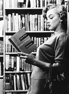 Marilyn reading a book written by her 3rd husband, Arthur Miller. Photographed by Ben Ross, 1951.