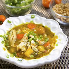 Jamaican curried chicken stew with rum and mango - tender chicken stew with vibrant Caribbean flavors and colors.