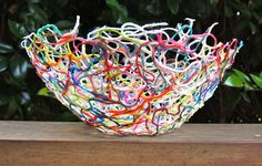 Yarn bowls made from yarn scraps and paste