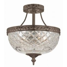 Bring a touch of classic elegance to your home with this semi-flush mount Richmond ceiling light, finished in English bronze. The glass globe is crafted of 24-percent clear lead crystal, creating a bright illumination and a dazzling effect.