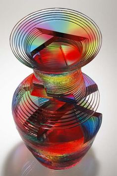 Solid Vase Form Designed and fabricated by Sidney Hutter. This fine art glass sculpture was created by laminating cut, ground and polished plate glass using dyed ultraviolet adhesive. Facets have been cut and polished to reveal the interior. Mosaic Glass, Stained Glass, Glass Bottles, Perfume Bottles, Dragonfly Art, Vases, Sculpture, Colored Glass, Art Pieces