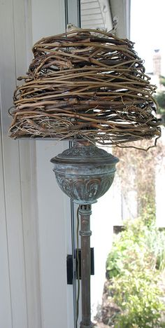Lampshade made from curly willow branches, paper mache bird finial (converted early 20th century kerosene lamp)