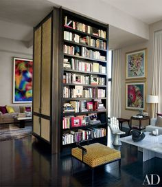 A floor-to-ceiling column acts as both a structural feature and a bookcase | archdigest.com