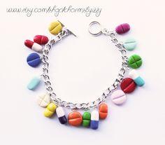 Kitsch Colourful Pill Polymer Clay Charm Bracelet. £6.16, via Etsy.