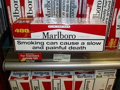 July 27 - Cigarette warning labels mandated by law in U.S.