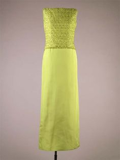 """Designer: Oleg Cassini (American, b. France 1913-2006)  Date Made: 1961  Medium: Silk, crystal beads, sequins  Dimensions: Top: length 10""""; Skirt: length: 43 1/2""""  Evening skirt and shell top in chartreuse silk faille embroidered with crystal beads and sequins. This ensemble was worn by First Lady Jacqueline Kennedy to the state dinner honoring Governor Luis Munoz Marin of Puerto Rico at the White House, Washington, DC on November 13, 1961 and in India in 1962."""