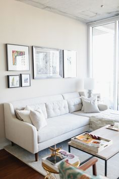 Colby Burlingame's Atlanta Apartment Tour #theeverygirl // white sectional #couch #living #style