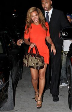 Beyonce wearing Tangerine Tango Dress and carrying a hot little bag