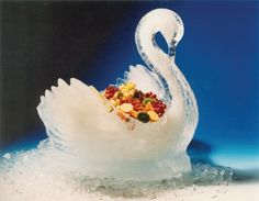 Swan ice sculpture bowl. Still sometimes used to serve fruit at gala celebrations such as weddings.