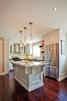 i am in love with ceiling height cabinets.  i'm not a fan of decorating the tops of cabinets but people think you're just lazy when you leave them empty.  problem solved!