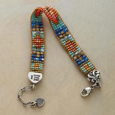 "KALEIDOSCOPE BRACELET Adonnah Langer handlooms each bracelet with her own Southwest-inspired designs. Multicolored Czech and Japanese beads drape smoothly against the wrist and close with a sterling silver lobster claw and extendable 1"" chain. USA. Exclusive. 6-1/2"" to 7-3/4""L."