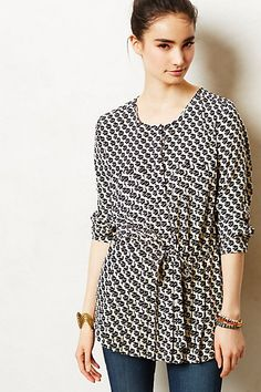 I like that it's a tunic that is cinched in at the waist, and it's a good pattern and color to put with brighter colors