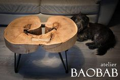 Handcrafted coffee table or bed side table made of natural wood with iron legs, entirely handmade. height: 45 cm length: 70 cm width: 50 cm The wooden part is 12 cm thick, that is why the table is pretty heavy, around 28 kg. This very beautiful live edge beech slice, with a very