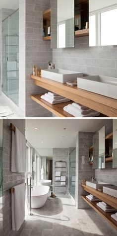 15 Examples of Bathroom Vanities That Have Open Shelving // This vanity features multiple sinks and a second floating piece of wood that creates a row of exposed shelving.