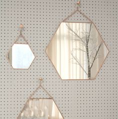 An antique style mirrorSmaller design availableThis decorative hanging hexangonal shaped copper mirror has a really lovely antique feel to it. With a metal chain to hang the mirror, the unique design will look just as good in a bathroom, bedroom or hallway either as a single mirror or set of three.  This mirror can be used for practical purposes or can be used for decorative purposes- it can help create the illusion of space. Copper, mirrored glass40cm x 35 cm